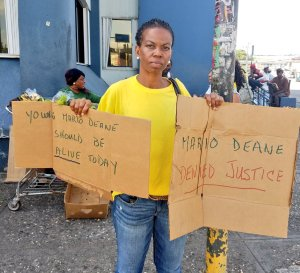 Mario Deane's mother protests on the two-year anniversary of his death. (Photo: Twitter)