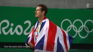 Tennis player Andy Murray wraps himself in the flag...