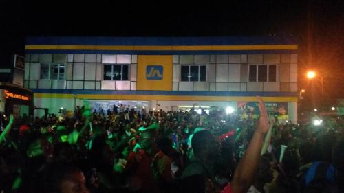 Jamaicans celebrate the 4 x 100 metro men's relay win last night in Half Way Tree, Kingston, where a big screen was set up. (Photo: Neville Charlton/Twitter)