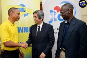 Permanent Secretary in the Ministry of Local Government and Community Development, Denzil Thorpe (right), with  Japan's Ambassador to Jamaica Masanori Nakano (centre), and the National Solid Waste Management Authority's Chairman, Dennis Chung, during the July 29 launch of the NSWMA's 'Waste Reduction through Waste Separation, Waste Diversion and Recycling' Pilot Project. (Photo: JIS)