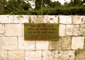 A simple stone memorial and plaque at Seville Great House in St. Ann. (My photo)