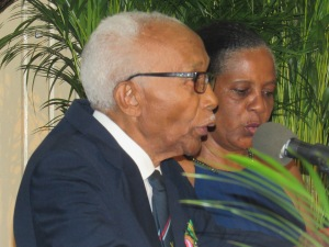 Mr. Barry Beckford, Life Vice President of RAFA Jamaica (580) Branch, gives the Exhortation, while Major (Retired) Johanna Lewin, Chair of RAFA Jamaica joins in. (My photo)