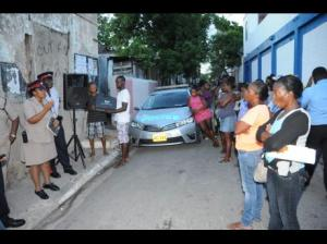 Police met with residents in Luke Lane last night to discuss the recent violence. (Photo: Jermaine Barnaby)