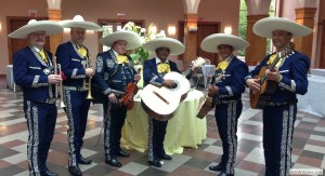 A typical modern mariachi band with their instruments.