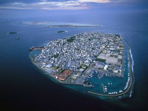 The Republic of Maldives consists of 1,190 islands in 20 atolls spread over 900 km in the Indian Ocean. Only 199 of these islands are inhabited with a population of slightly over 300,000 people. The islands highest elevation is 2 meters or about 6 feet above sea level. This is the capital, Male.