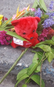 A teddy bear and flowers, for Demario. (Photo: Hubie Chin)