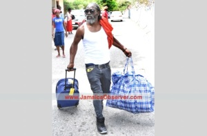 Upset and angry, a deportee arrives at Norman Manley International Airport in Kingston. (Photo: Jamaica Observer)