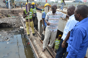 Local Government and Community Development Minister, Hon. Desmond McKenzie (3rd right), converses with workmen involved in the road expansion project by the National Works Agency (NWA) on Marcus Garvey Drive in Kingston, during a tour of the area on Friday. (Photo: JIS)
