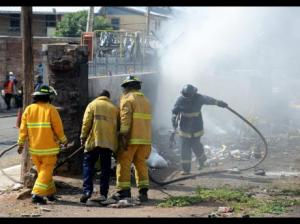 This lot, where garbage was on fire, created huge health problems for nearby schools. And this is NOT the first time, it appears! (Photo: Ricardo Makyn/Gleaner)