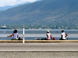 Admiring the view: Volunteers take a break on the Kingston Harbour side. (My photo)