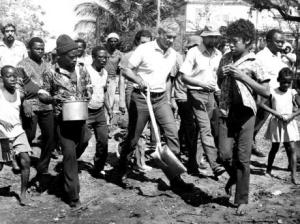 Man of the People: In this Gleaner photograph, Prime Minister Michael Manley carries his shovel as he joins Kingston Jaycees in their joint effort with Rae Town Fishermen's Cooperative to construct a community health clinic on Labour Day, 1975.