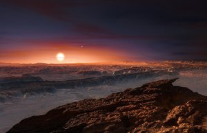 An artist's depiction of the surface of the planet Proxima b as it orbits the red dwarf star Proxima Centauri, the closest star to our solar system. The planet is a bit more massive than Earth, scientists say, and circles its star once every 11 days. ESO/M. Kornmesser/Nature