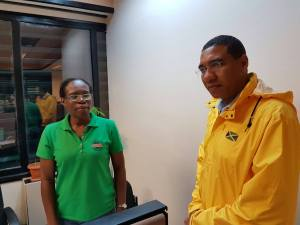 Neatly attired in a waterproof jacket with the Jamaican flag on it, Prime Minister Andrew Holness visited the offices of the Office of Disaster Preparedness and Emergency Management (ODPEM) today. (Photo: Facebook)