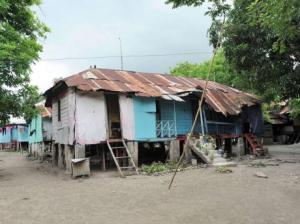 """The appalling """"sugar barracks"""" in Golden Grove, St. Thomas. In 2012 residents were promised new homes, but the residents are now moving into them half-finished. (Photo: Gleaner)"""