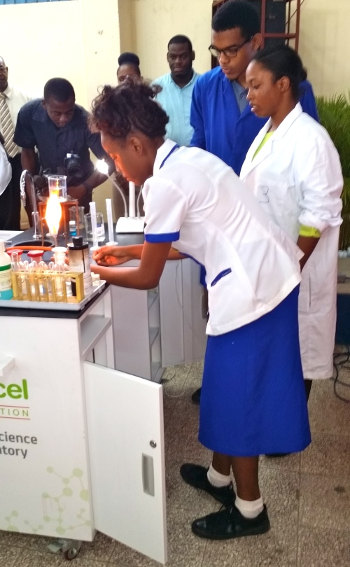 A young scientist in the making gets to work on the Mobile Science Lab at Jose Marti Technical High School. (My photo)