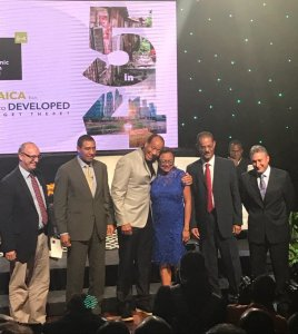EGC Chairman Michael Lee Chin (3rd from left) cuddles Helene Davis Whyte, President of the Jamaica Confederation of Trade Unions (JCTU). 2nd from left is Prime Minister Andrew Holness. By the way, the EGC itself consists of 80 per cent men - eight men and two women. (Photo: Twitter)
