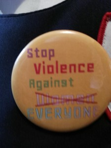 International Men's Day button at University of the West Indies event.