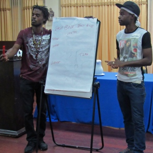 Young men share their thoughts at a mentoring workshop for boys, organized by Panos Caribbean, in June. (My photo)