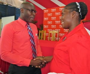 Digicel Foundation's Dane Richardson meets up with Ms. Astenett Ranger-Gordon, Teacher of Integrated Science and Biology at Jose Marti Technical High School. (My photo)