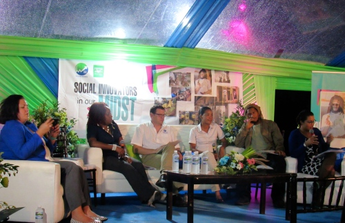 """Panelists in discussion under the cozy, colorful tent at the SEBI discussion """"Let's Talk Social Enterprise Policy"""" on November 17. (My photo)"""
