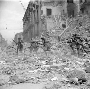 My father was a part of this...The British Army in Sicily 1943 Infantry scramble over rubble in a devastated street in Catania, 5 August 1943. (Photo: Imperial War Museum Archives)
