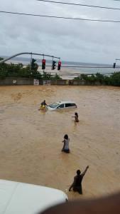 Flooding on the main coastal road (North Coast Highway) at Runaway Bay, St. Ann.