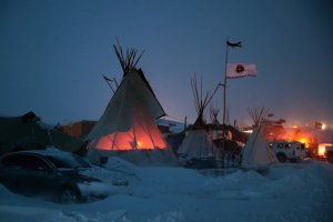 CANNON BALL, ND - DECEMBER 06: Activists at Oceti Sakowin near the Standing Rock Sioux Reservation brace for sub-zero temperatures expected overnight on December 6, 2016 outside Cannon Ball, North Dakota. Native Americans and activists from around the country have been at the camp for several months trying to halt the construction of the Dakota Access Pipeline. The proposed 1,172-mile-long pipeline would transport oil from the North Dakota Bakken region through South Dakota, Iowa and into Illinois. (Photo by Scott Olson/Getty Images)
