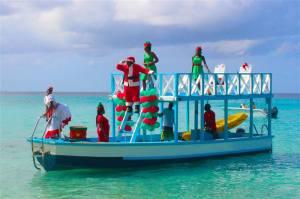 Tweeted by Elegant Resorts in the UK, here's a Bajan Santa arriving by boat...