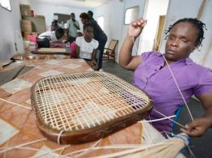 Maxine McIntosh doing caning work at Superior Crafts and More. (Photo: Gleaner)
