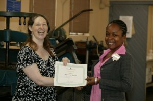 Dianna Clise (left) Conservation Consultant for the National Library of Jamaica's Enos Nuttall Manuscript Collection, presenting a Certificate to Bernadette Worrell at a Conservation Workshop on Preserving Manuscripts, held at the NLJ on April 21, 2010 through the Ambassador Fund for Cultural Preservation.