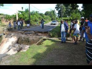 The community of Dumbarton, St. Ann are not going to see their road fixed before 2017. Holidays come first, and the funds have to be found, contractor engaged etc... (Photo: Gleaner)