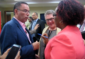 Minister Daryl Vaz speaks with Professor Denise Eldemire (center) and Principal Director of the Climate Change Division Una May Gordon at the symposium. (My photo)