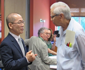 Serious talk: Chair of the Intergovernmental Panel on Climate Change Dr. Hoesung Lee (left) in discussion with Professor Emeritus Anthony Chen at the IPCC Conference at the University of the West Indies this week. (My photo)