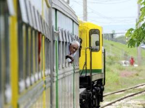Then (and now) Transport Minister Mike Henry enjoying a ride on the lovely train that operated for a short while between May Pen and Linstead, in 2011. (Photo: Gleaner)