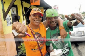 The obligatory photo of PNP and JLP supporters hugging up - this was taken on Nomination Day, November 11. (Photo: Jamaica Observer)