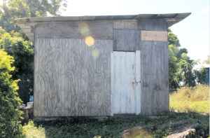 This is the house where the body of 19-year-old Tashoy Barrett was found on Monday. Her boyfriend, 29-year-old Odaine Keyes, has been charged with her murder. (Photo: Jamaica Observer)