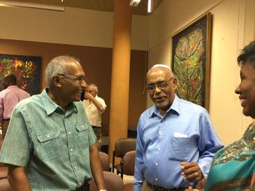 (l-r) Dr. Girjanauth Boodraj (Hindu), Mr. Herman Alvaranga (Jewish) and Mrs. Sandra Grey Alvaranga (Christian) chat at the World Religion Day event. (Photo courtesy of Dorothy Whyte)