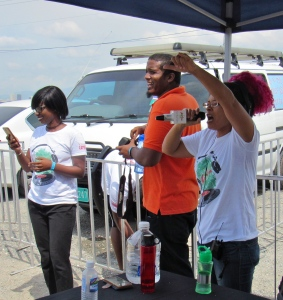 "Even beach clean ups can have an ambience - busy, engaged, a little rough sometimes…and especially when a little dancehall ""vibe"" is involved - here courtesy of Tricia ""ZJ Sparks"" Spence from Zip FM, seen here conducting an impromptu dance by some of the young ones who had some energy left! (My photo)"