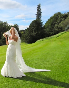 Brides often almost unconsciously acquire a kind of grace - perhaps because of their beautiful gowns and veil. Here's one bride in England, caught in a graceful moment by my camera.