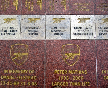 Just a few of the many names inscribed on tiles outside the Emirates Stadium in north London. Gooners from all over the world! (My photo)