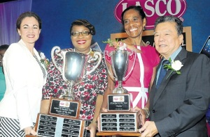 Heather Murray (2nd right, in pink) receives the LASCO Principal of the Year Award for 2014. (Photo: JIS)