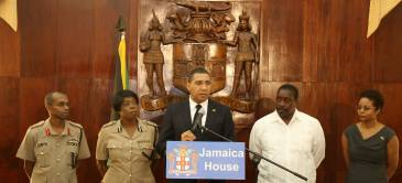 "Prime Minister Andrew Holness (center) at last week's press briefing with (l-r) Major General ""Rocky"" Meade, Chief of Staff, Jamaica Defence Force; Acting Commissioner of Police Novelette Grant; Minister of National Security Robert Montague; and Attorney General Marlene Malahoo Forte. (Photo: Prime Minister's Facebook page)"