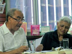 """Earl McKenzie reads Pamela Mordecai's poetry at the launch of """"Subversive Sonnets."""" (My photo)"""