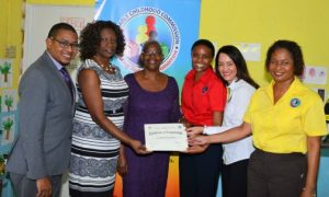 State Minister Floyd Green (left) shares in the Early Childhood Commission (ECC) certification ceremony at the St Margaret's Bay Basic School in Portland as Acting Executive Director of the ECC Karlene Degrasse-Deslandes (right), presents the certificate to principal of the school, Marcia Barnes (third left). Others (from second left) are: School Board Chair Kerri-Ann Edwards; ECC Chair Trisha Williams-Singh and One Jamaica Foundation Director Ann-Marie Vaz.