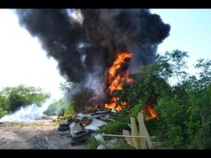 Burning garbage at an illegal dump in Six Miles, St. Andrew. (Photo: Errol Crosby/Gleaner)