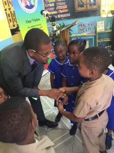 State Minister for Youth Floyd Green chats with the children of St. Margaret's Bay Basic School.