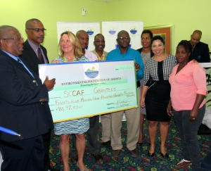 """Some of the grantees pose with a big """"cheque"""" with EFJ Chair Professor Dale Webber and Lt. Col. Oral Khan. (My photo)"""