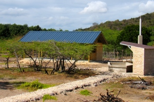 The blue roof is a building designed for social activities. To the right is the dipping pond. (My photo)