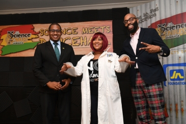 "Dancehall artiste, Tifa (centre), show she's ""scientifically swaggerific"" after being robed in her Science Genius Jamaica lab coat by Hip-Hop Professor, Professor Christopher Emdin (right), and Minster of State in the Ministry of Education, Youth and Culture, Floyd Green. Tifa will be among dancehall artistes who will mentor the 20 schools that will participate in Science Genius Jamaica launched on February 22. (Photo: JN Foundation)"