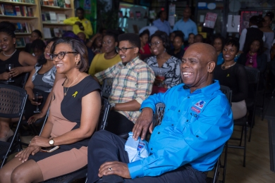 The audience - including Chairman and Managing Director of Kingston Bookshop, Hon. Steadman Fuller, Custos of Kingston (front right) - enjoying the readings thoroughly.